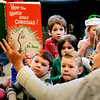 "BRYAN EATON/Staff photo. Amesbury Elementary School teacher Alexandra Nicols reads ""How the Grinch Stole Christmas"" to kindergartners while waiting for others to arrive. They were preparing to sing Christmas carols and seasonal songs at the Amesbury Senior Center."