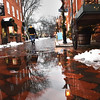 BRYAN EATON/Staff photo. Warm temperatures and rain melted some snow on Tuesday, here in a view up Newburyport's Inn Street. The melting will be shortlived as the temperature isn't forecast to hit above freezing until Saturday.