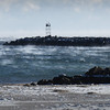BRYAN EATON/Staff photo. Sea smoke covers the ocean at the north jetty of the Merrimack River and beyond at Salisbury Beach. It's caused when extremely cold air passes over warmer water which was 45 degrees yesterday.