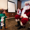 JIM VAIKNORAS Lydia Wojtuliewicz, 19 months, get a thumbs up from Santa after she told him what he wanted for Christmas during his visit to the West Newbury Police Station Saturday morning.