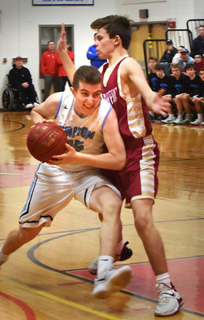 BRYAN EATON/Staff photo. Triton's Kyle Odoy pushes past Newburyport's Jacob Robertson.