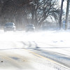 BRYAN EATON/Staff photo. Tuesday's wind blows snow across High Road in Newbury creating drifts and curbing visibility and making the cold weather feel worse. Continued cold weather is in the forecast into the weekend.
