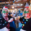 JIM VAIKNORAS/Staff photo Agnes Donovan, of Plum Island, and Lea Cormier of Newburyport enjoy some holiday cheer at the Christmas Jamboree at the Beach Coma on Plum Island Sunday afternoon.