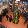 JIM VAIKNORAS/Staff photo Shoppers make their way past the tree at the Tannery in Newburyport Friday afternoon.The tree, which is put up ever year, is made of recycled bottles.