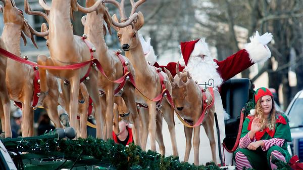 JIM VAIKNORAS/Staff photo Santa arrives at the Merrimac Santa Parade Sunday in Merrimac.