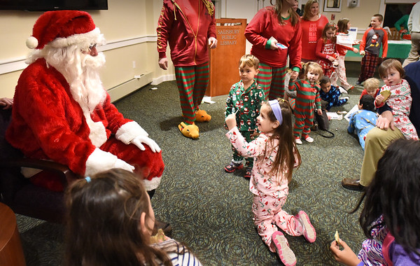 BRYAN EATON/Staff photo. The Salisbury Elementary School Family Connection and the Salisbury Public Library hosted a reading of the Polar Express on Tuesday night at the libray. Youngsters were surprised by the visit of Santa Claus who was escorted there by the Salisbury Police Department and Salisbury Fire Department's engine then treated with North Pole snacks which were donated by Joe's Playland.