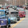 JIM VAIKNORAS/Staff photo Antiques cars make their way up Church Street during the Merrimac Santa Parade Sunday in Merrimac.
