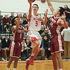 JIM VAIKNORAS/ Staff photo  Amesbury's John Sydlowski glides to the basket against Newburyport during the finals of the Mike Rowinski Tournament at Amesbury High School Thursday night.