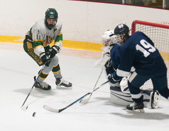 JIM VAIKNORAS/Staff photo Pentucket's Keegan Comeau makes a move against Lynnfield during their game at Veteran's Rink in Haverhill Wednesday night.