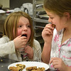 BRYAN EATON/Staff photo.  Viveah Currier, 6, left, and Star Mispilkin, 8, dig in to their culinary creations.