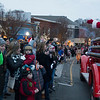 JIM VAIKNORAS/Staff photo Santa waves to the crowd during the Amesbury Santa Parade and Tree Lighting in Market Square Saturday.