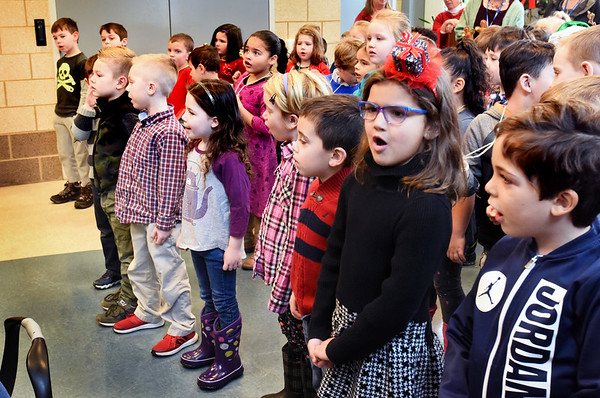 "BRYAN EATON/Staff photo. Kindergartners sing ""Frosty the Snowman"" at the Amesbury Senior Center this week. The youngsters from Amesbury Elementary School have been making this an annual event for them for several years now."