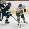 JIM VAIKNORAS/Staff photo Pentucket's Cameron Martin makes a move on Lynnfield's Joseph Mack during their game at Veterans Rink in Haverhill Wednesday night.