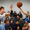 BRYAN EATON/Staff photo. Georgetown's Hunter Lane and Triton's Colin Ganzenmuller grab for the ball.
