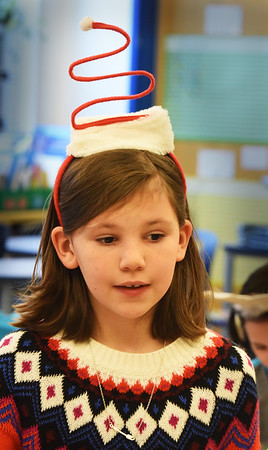 BRYAN EATON/Staff photo. Teagan Dougherty, 9, wears a Santa Spring Hat in Arna Beaudoin's class at the Bresnahan School in Newburyport on Monday. They're celebrating Holiday Spirit Week with Monday as Merry Monday, and today is Snow Much Fun Tuesday and so on.