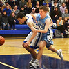 BRYAN EATON/Staff photo. Triton's Kyle Odoy moves in on Matthew Scearbo.
