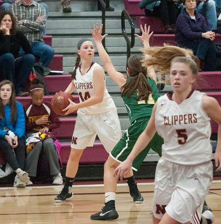 JIM VAIKNORAS/Staff photo Newburyport's Meghan Winn looks for a cutter against North Reading at Newburyport High Friday night.