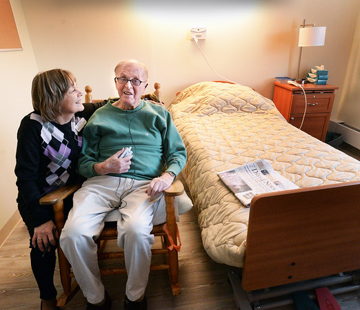 BRYAN EATON/Staff photo. Port Healthcare social worker Betty Sloban visits with John Callahan, 90, a native of Newbury and retired accountant. He was the first resident to be moved to the new facility on Hale Street in Newburyport.