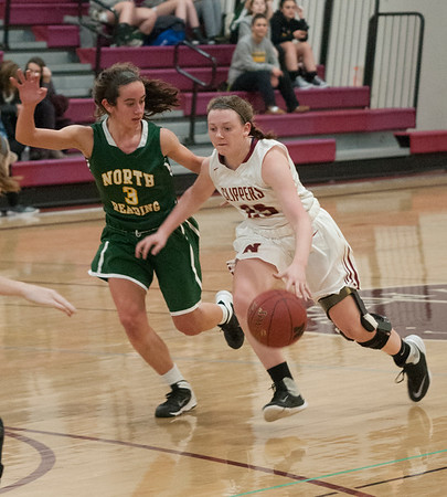 JIM VAIKNORAS/Staff photo Newburyport's Anna Hickman drives on a North Reading player at Newburyport High Friday night.
