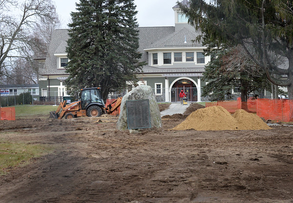 BRYAN EATON/Staff photo. The town common in Salisbury Square is being renovated and getting a new configuration including new walkways, and this one leading up to the two-year-old library.