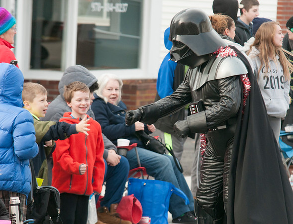 JIM VAIKNORAS/Staff photo Darth Vader spreads Christmas cheer, and the Force, during the Merrimac Santa Parade Sunday in Merrimac.