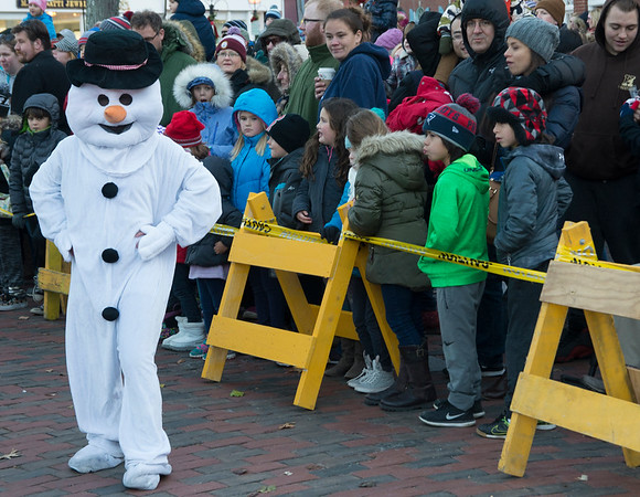 """With a corncob pipe, and a button nose""<br /> JIM VAIKNORAS/Staff photo Frosty entertains the crowd at the annual Santa Parade and Tree Lighting in Market Square in Newburyport Sunday."