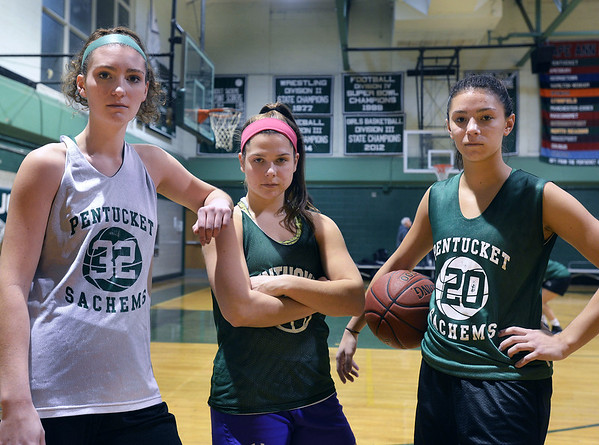 CARL RUSSO/staff photo. Pentucket girls basketball stars, from left, Liv Cross,  Angelina Yaccubacci and Casey Hunt. 12/14/2017