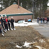 BRYAN EATON/Staff photo. Rowley officials recently gathered for a groundbreaking ceremony at the site of the new fire and police stations on Haverhill Street. The present police station, rear, will be added to on the westerly side, and the firestation to the east with the driveway coming through where the dignitaries are pictured. Haverhill Street is to the left of photo view.