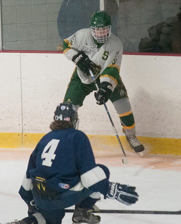 JIM VAIKNORAS/Staff photo Pentucket's Josh Smith controls teh puck in the corner against Lynnfield during their game at Veteran's Rink in Haverhill Wednesday night.