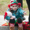 JIM VAIKNORAS/Staff photo Alana Cote, 4, is all bundled up as she waits for Santa at the Merrimac Santa Parade Sunday in Merrimac.
