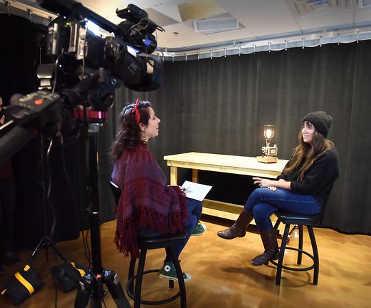 BRYAN EATON/Staff photo. Caterina Masia, left, conducts an interview with Nikole Beckwith at Port Media. Now living in Los Angeles Beckwith, a Newburyport native, is an award winning screenwriter and will be featured for Women's HERstory Month.
