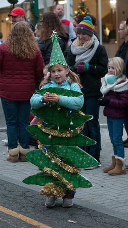 """"""" You branches green delight us""""<br /> JIM VAIKNORAS/Staff photo Tori Woodsom, 5, gives out candy during the Amesbury Santa Parade and Tree Lighting in Market Square Saturday."""