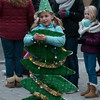 """ You branches green delight us""<br /> JIM VAIKNORAS/Staff photo Tori Woodsom, 5, gives out candy during the Amesbury Santa Parade and Tree Lighting in Market Square Saturday."