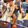 BRYAN EATON/Staff photo. Triton's Jared Drouin reaches over Georgetown's Hunter Lane.