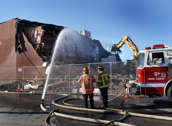 BRYAN EATON/Staff photo. The Newburyport Fire Department was on hand do hose down the site to keep the dust down.