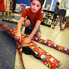 "BRYAN EATON/Staff photo. The First Religious Society, Unitarian Universalist, of Newburyport sponsored a second holiday ""Gift of Giving"" event at the Bresnahan School. Children from the YWCA after-school program chose and wrapped free gifts for their parents which were provided by the FRS and local community members. Ethan Malio, 7, wrapped a present for his father during the Wednesday afternoon event.<br />  <br /> Nancy Crochiere"