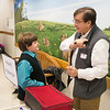 JIM VAIKNORAS/Staff photo Bill Wright interviews Deven Wright at the Cashman School Friday. Students at the school dressed up as immigrants and experienced what it was like to go through Ellis Island. Deven was an immigrant from Canada.