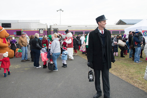 JIM VAIKNORAS/Staff photo Conductor Bob Hoffman welcomes riders aboard the Polar Express at the MBTA station in Newburyport Saturday morning. Over 3500 passengers rode the train sponsored by the Immaculate Conception in it's 17th year.