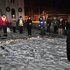 BRYAN EATON/Staff photo. A vigil was held last night against gun violence on the fifty anniversary of the mass shooting at Sandy Hook Elementary School outside the Main Street Congregational Church in Amesbury. People placed rocks within an outline of the United States in the location of the 35 mass shooting around the country since that event.