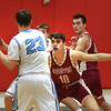 BRYAN EATON/Staff photo. Newburyport's Bretton Ross covers Triton's William Parsons.