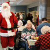 BRYAN EATON/Staff photo. Santa Claus was on hand at Breakfast With the Chiefs at the Amesbury Senior Center on Friday morning. He was handing out small gifts including candy canes.