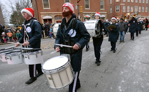 BRYAN EATON/Staff photo. Members of the Triton Regional High School Marching Band make their way through Market Square.