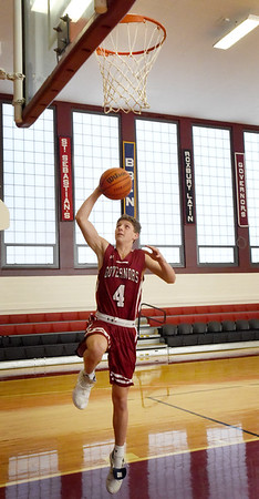 BRYAN EATON/Staff Photo. Newburyport's Will Batchelder plays for the Governor's Academy.