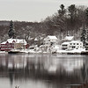 BRYAN EATON/Staff Photo. Snow-covered homes and Lowell's Boat Shop on Amesbury's Point Shore reflect in the Merrimack River on Wednesday morning. The photo was taken from Spring Lane in Newburyport near the Chailey Mansion.