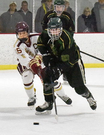 BRYAN EATON/Staff Photo. Pentucket's Jack Stewart moves the puck past the Clippers' Tyler Koglin.