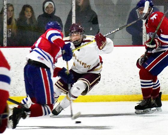 BRYAN EATON/Staff Photo. Newburyport's Ryan Archer moves to cutoff a Burlington player.