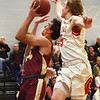 BRYAN EATON/Staff photo. Amesbury's Kyle Donovan is called on a foul on Peter McLaren.