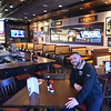 BRYAN EATON/Staff Photo. 99 Restuarant general manager Kevin Deyak is ready for business at the company's 108th location at the Carriagetown Plaza in Amesbury.