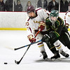 BRYAN EATON/Staff Photo. Newburyport's Ben Reynolds and Jack Stewart vie for the puck.