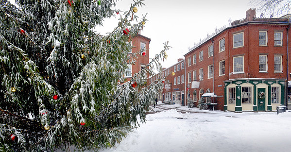 BRYAN EATON/Staff photo. The Christmas Tree in Newburyport's Market Square is covered with snow as hours before it was lit as a huge crowd looked on.